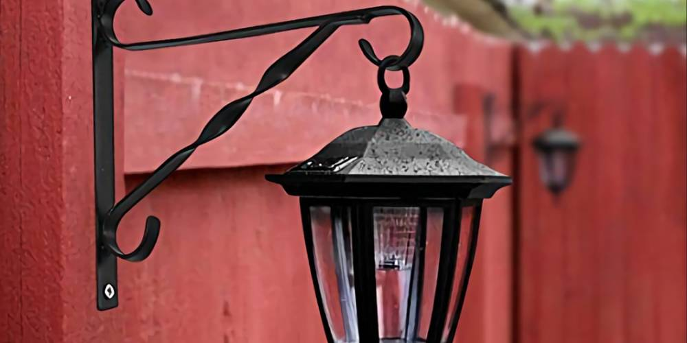 Use Black Plant Hanging Bracket To Solar Light Attached The Wall